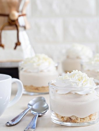 White Chocolate Tiramisu Pudding Cups come together in minutes for a delicious and simple dessert. They're perfect for holiday parties, or a Wednesday night.