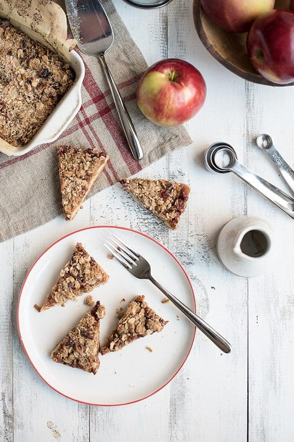 Apple Cranberry Crumble Bars are a sweet and crunchy treat that celebrates the fall season. Perfect for breakfast or dessert!