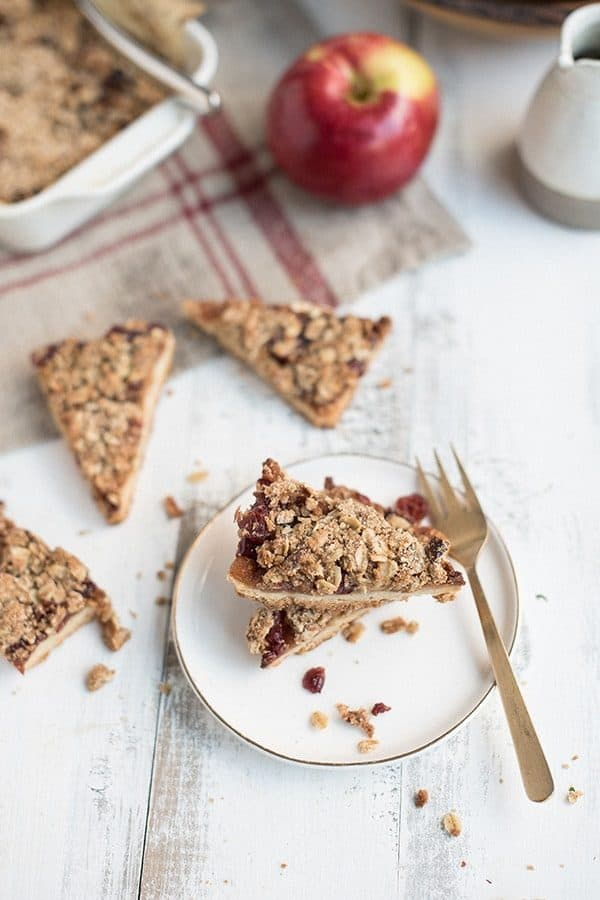 Celebrate fall with these Apple Cranberry Crumble Bars. They're sweet, crunchy and the perfect dessert after a day of apple picking.