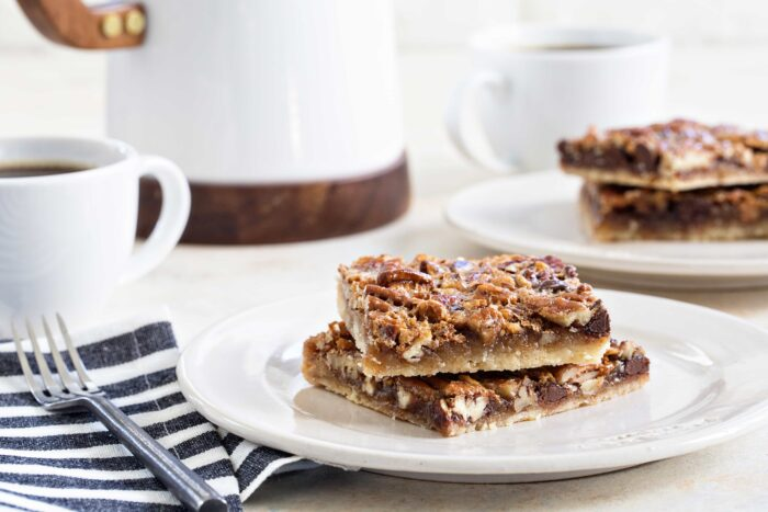 Chocolate Bourbon Pecan Bars are a fun twist on classic pecan pie. This recipe makes 48 bars, so it's perfect for the holidays!