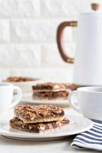 Chocolate Bourbon Pecan Bars are a fun twist on classic pecan pie. They're the perfect bar dessert for the holidays!