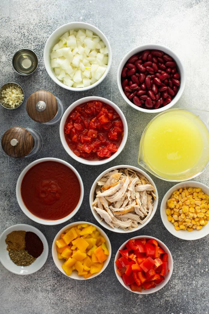 Easy chicken chili ingredients arranged on a gray countertop