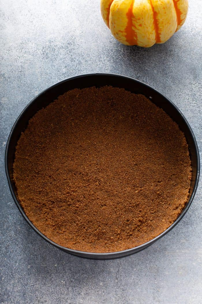 Gingersnap cookie crust in a springform pan