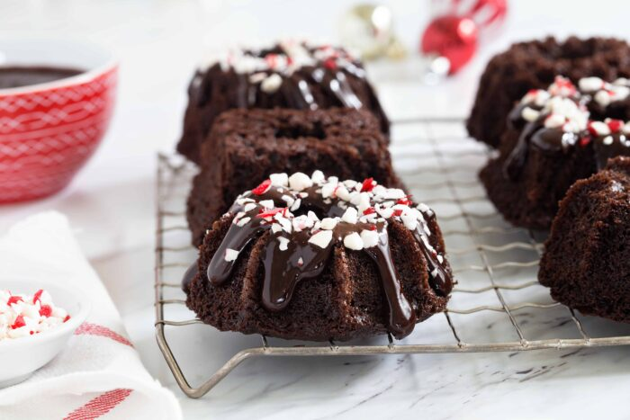 Chocolate Peppermint Mini Bundt Cakes are a fun and delicious dessert for any holiday party. So festive!
