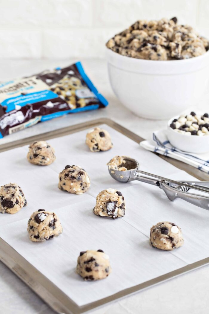 "Cookies ""N' Creme Cookies are bursting with big flavor thanks to white chips and chocolate cookie bits. They're perfect for any holiday party!"