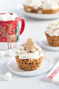 Gingerbread Marshmallow Treat Cupcakes are an adorable and delicious addition to any holiday dessert plate! Festive sprinkles make and mini gingerbread marshmallows make them merry and bright