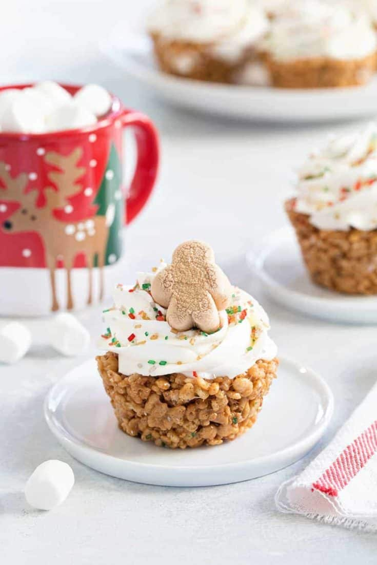 Gingerbread Marshmallow Treat Cupcakes are an adorable and delicious addition to any holiday dessert plate! Festive sprinkles and mini gingerbread marshmallows make them extra special.