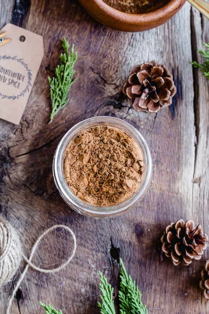 This homemade Chai Spice Blend is the perfect warm and cozy spice mixture for the holiday season.  Add a cute tag, twine and little greenery for the perfect handmade hostess gift!
