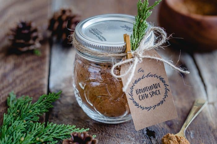 This homemade Chai Spice Blend is the perfect warm and cozy spice mixture for the holiday season.  Add a cute tag, twine and little greenery an easy and thoughtful handmade gift!