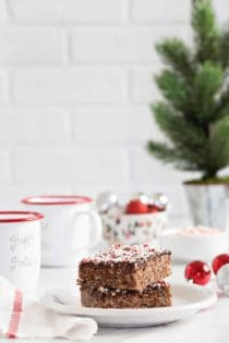 Chocolate Peppermint Scotcheroos are a fun and festive spin on a classic no-bake dessert. Chocolate hazelnut spread, dark chocolate chips, and crushed candy canes make them extra special!