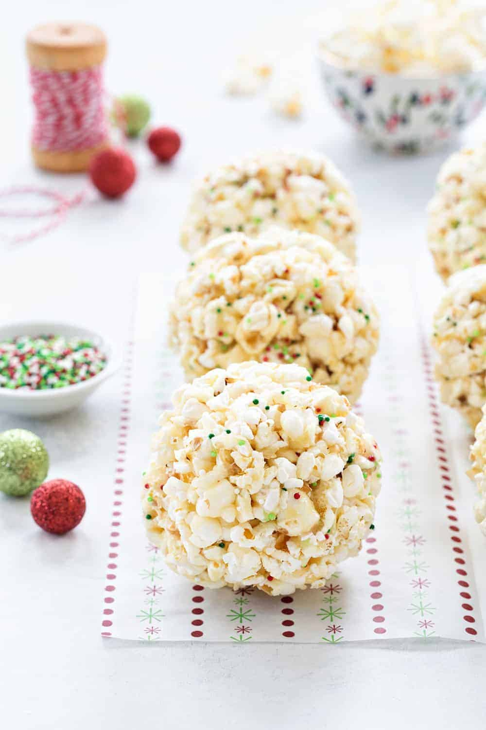 Popcorn Balls are a fun and delicious way to celebrate the season. This simple recipe is a great base for so many flavor combinations - the possibilities are endless!