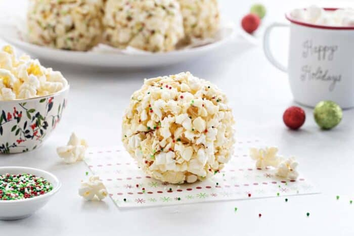 Popcorn Balls are a fun and delicious way to celebrate the season. This simple recipe is a great base for so many flavor combinations. So easy and perfect for the holidays!
