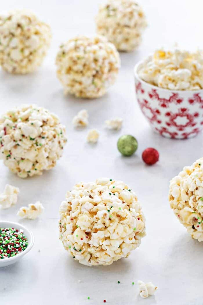 Popcorn Balls are a fun and delicious way to celebrate the season. This simple recipe is a great base for so many flavor combinations. Kids will LOVE these!