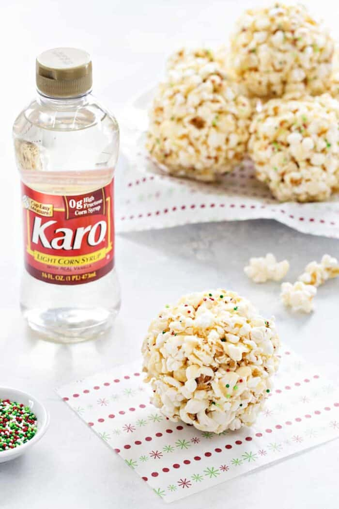 Popcorn Balls are a fun and delicious way to celebrate the season. This simple recipe is a great base for so many flavor combinations. Such a fun holiday tradition!