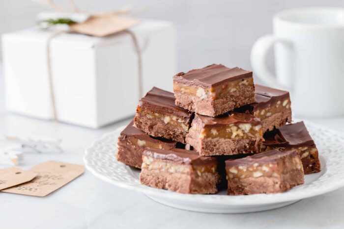 Turtle Fudge is rich, delicious and the perfect addition to any holiday dessert plate. Add a simple box and pretty tag and you're good to go!