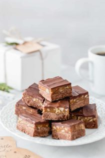 Turtle Fudge is rich, delicious and the perfect addition to any holiday dessert plate. The decadent layer of caramel and pecans makes it absolutely irresistible.