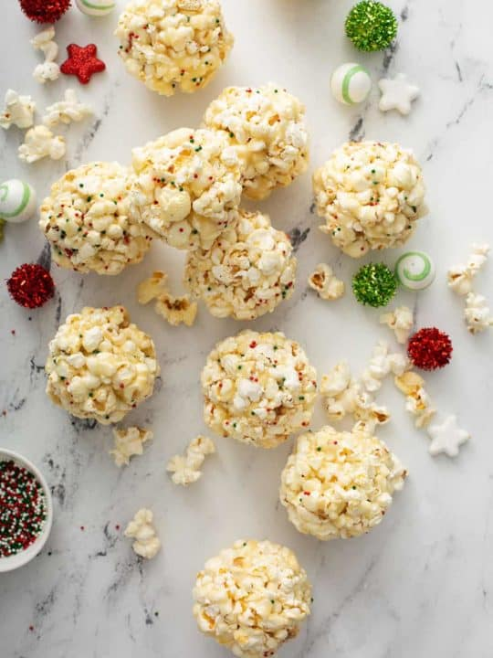 popcorn balls scattered on a marble countertop