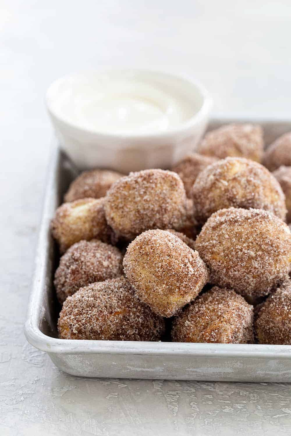 Cinnamon Sugar Soft Pretzel Bites are super simple to make. Serve them up with a side of cream cheese icing for the ultimate game day snack! So fun!