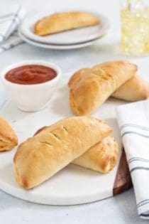 Easy Pizza Pockets come together quikly and are totally delish. Fill them with your favorite pizza toppings for the perfect game day snack!