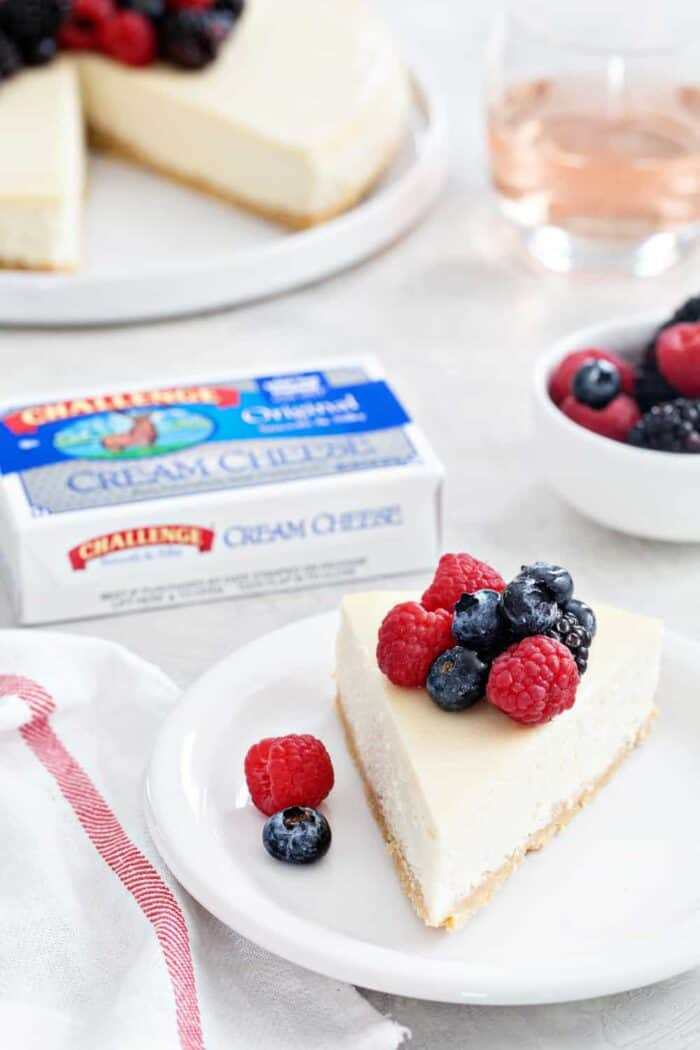 Rosé Cheesecake is rich, creamy, and full of flavor. A sugar cookie crust and rosé soaked berries make it totally irresistible!