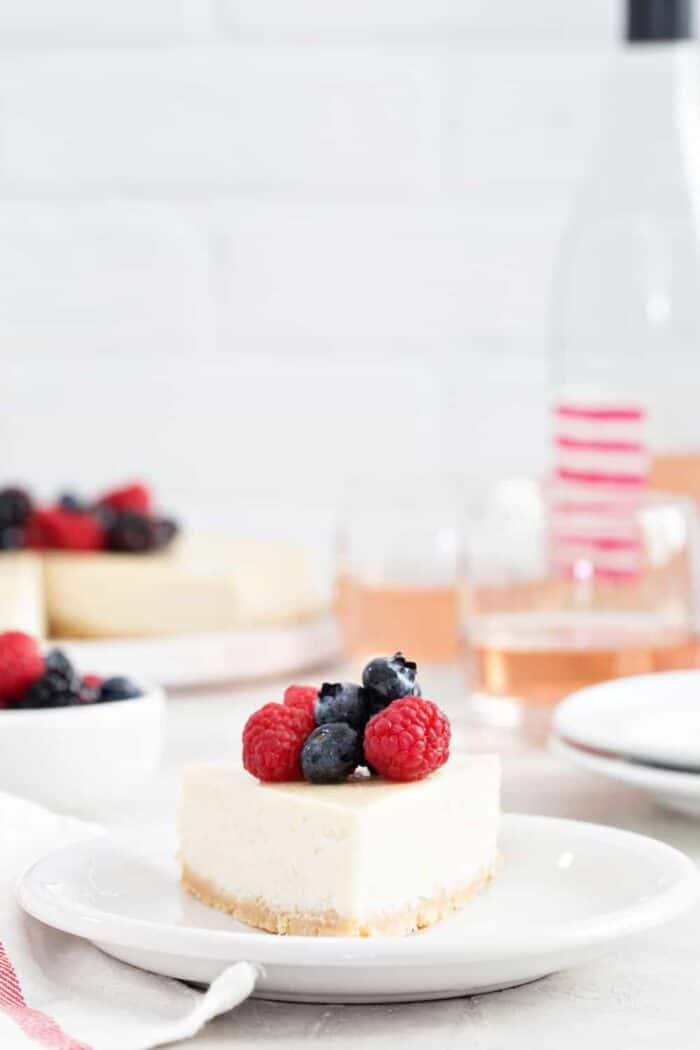 Rosé Cheesecake is rich, creamy, and full of flavor. Perfect for the Rosé lover in your life!
