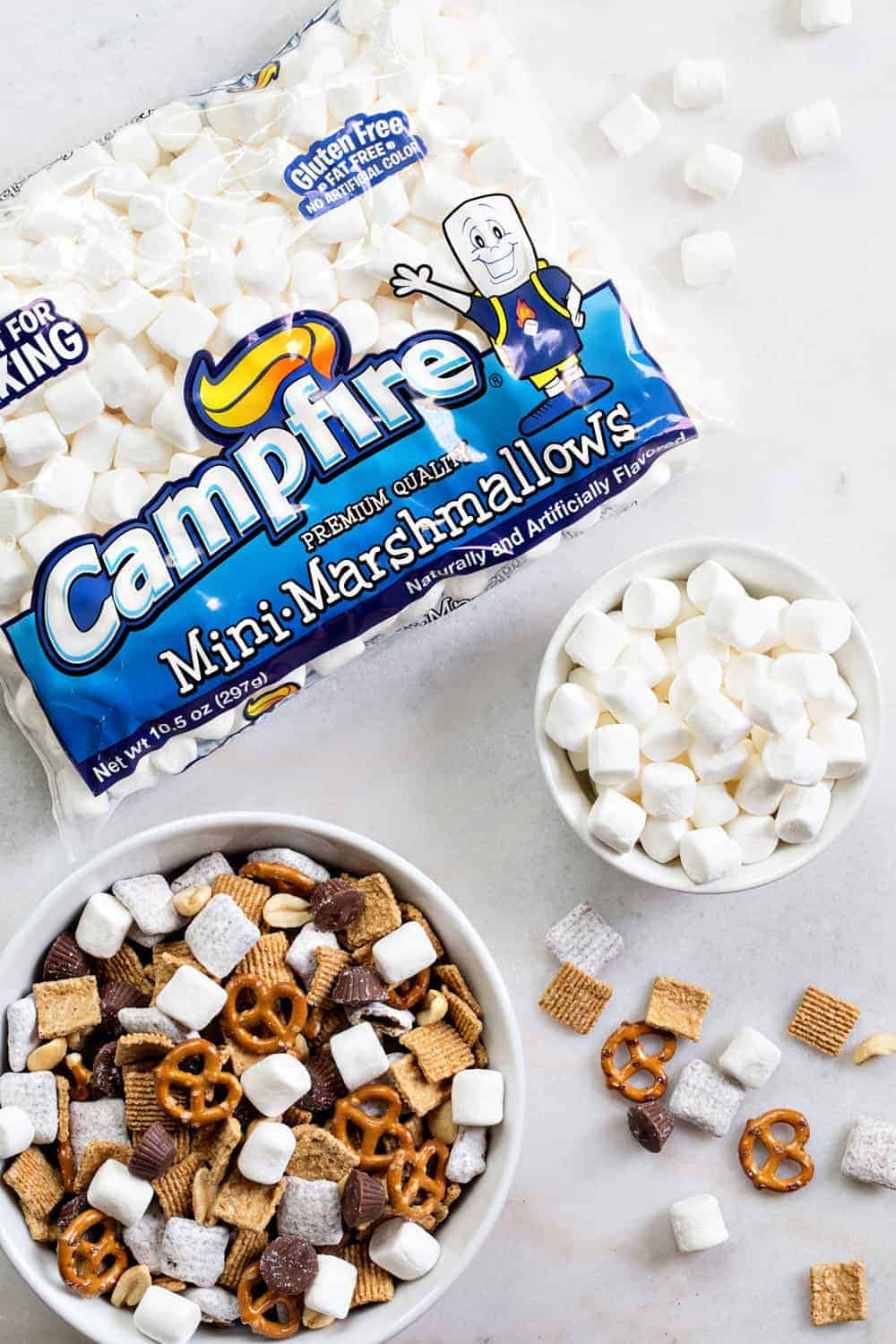 S'mores Snack Mix combines graham cereal, puppy chow, pretzels, peanuts, mini peanut butter cups and marshmallows to create the most amazing snack mix! Simple and totally delicious!