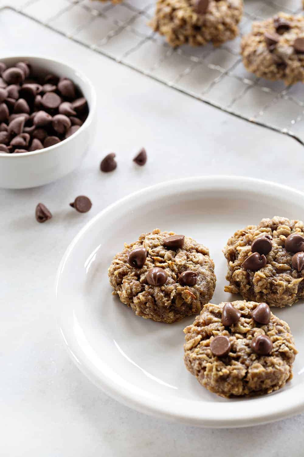 Banana Oatmeal Cookies are soft, chewy and studded with chocolate. Stir in walnuts or pecans for a little crunch!