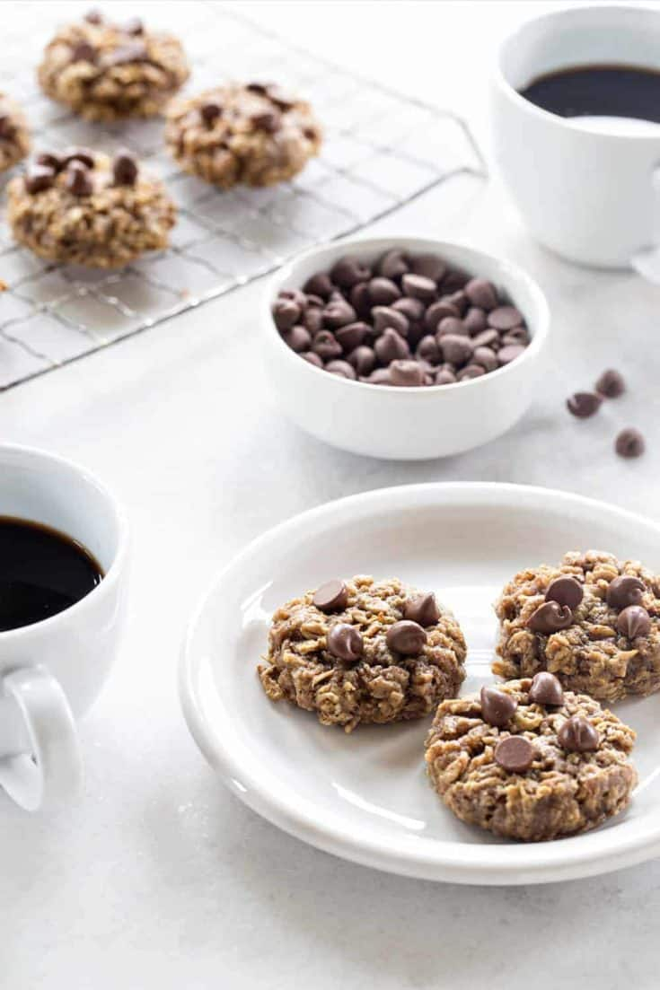 Banana Oatmeal Cookies are soft, chewy and studded with chocolate. Pair them with a mug of your favorite coffee for breakfast, or serve them up for dessert!