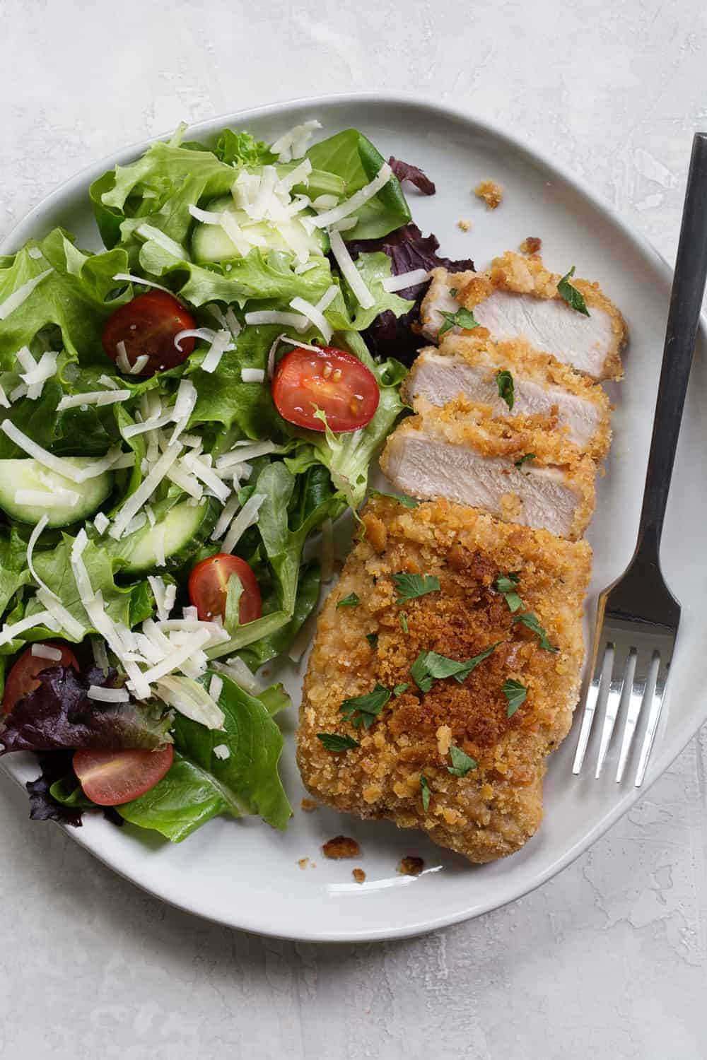 Easy Baked Pork Chops are as simple as they are delicious. Serve them up with potatoes and a crisp salad for weeknight dinner perfection.