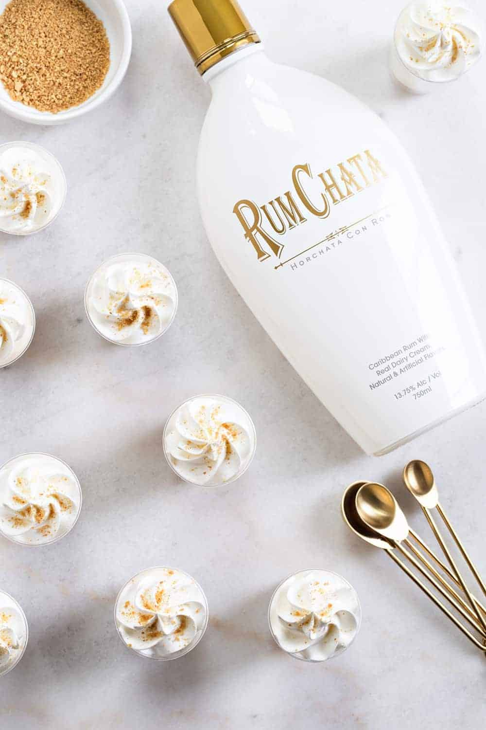RumChata Cheesecake Pudding Shots come together with 5 simple ingredients. Simple and delicious!