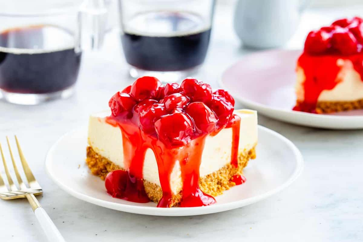 Instant Pot Cheesecake with a traditional graham cracker crust and finished with canned cherries.