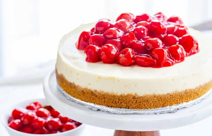 Instant Pot Cheesecake topped with cherries. Easy and delicious.