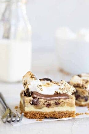 Cookie Dough Cheesecake S'mores combine all the flavor of cheesecake, chocolate chip cookie dough AND s'mores into seriously incredible dessert! You gotta try them!