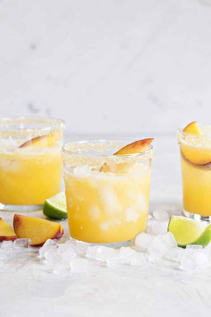 Sparkling Peach Margaritas are the perfect way to celebrate summer. They're light, sweet and bursting with fresh peach flavor!