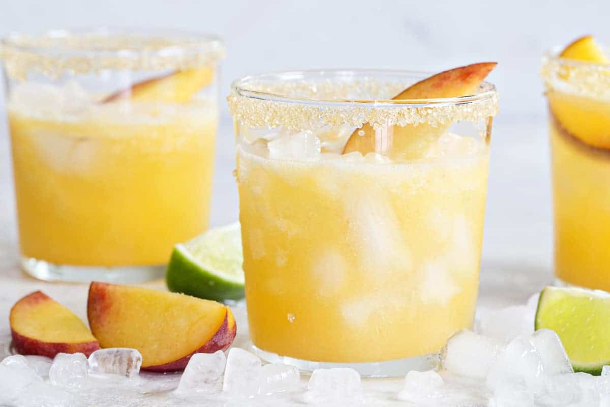 Sparkling Peach Margaritas are the perfect way to celebrate the season! Fresh, fruity and totally delicious!