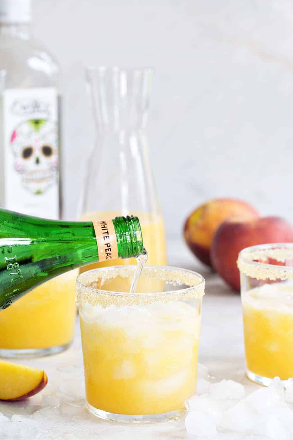 Sparkling Peach Margaritas are the perfect way to celebrate summer. They're light, sweet and bursting with fresh summer flavors!