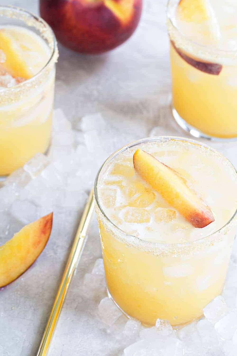 Sparkling Peach Margaritas are the perfect way to celebrate summer.  Simple and delicious!