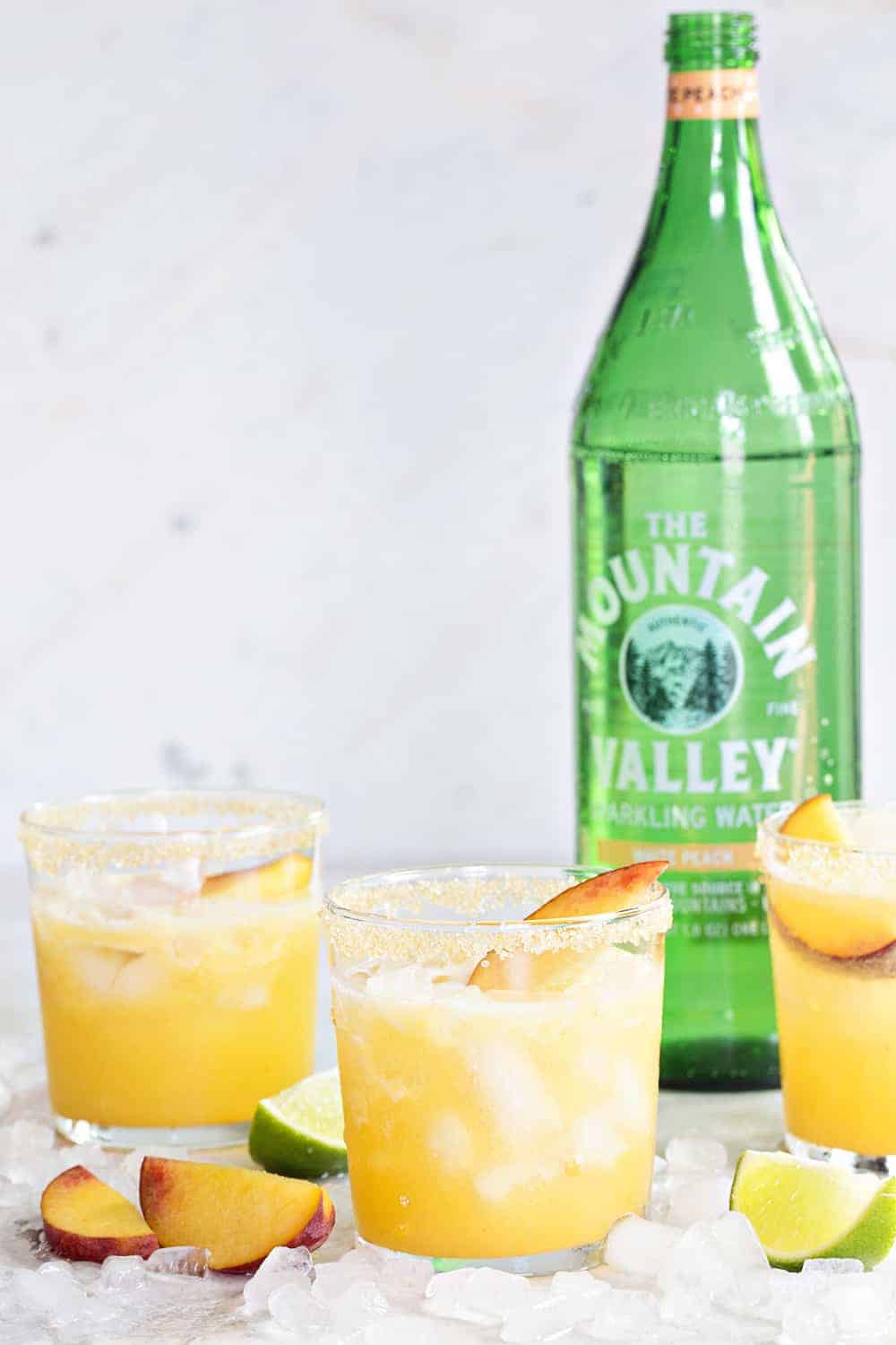 Sparkling Peach Margaritas are going to be your new favorite cocktail for summer entertaining. They're fresh, fruity and totally delish!