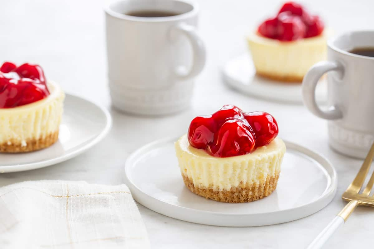 Mini Cherry Almond Cheesecakes are simple and totally adorable. Perfect for entertaining, or a simple weeknight treat!