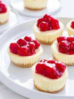 Mini Cherry Almond Cheesecakes are a simple and delicious sweet treat for just about any occasion. They're fun to make, and even more fun to eat!