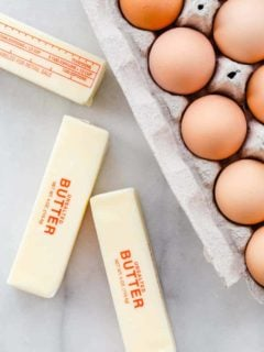 Three sticks of butter and a carton of eggs