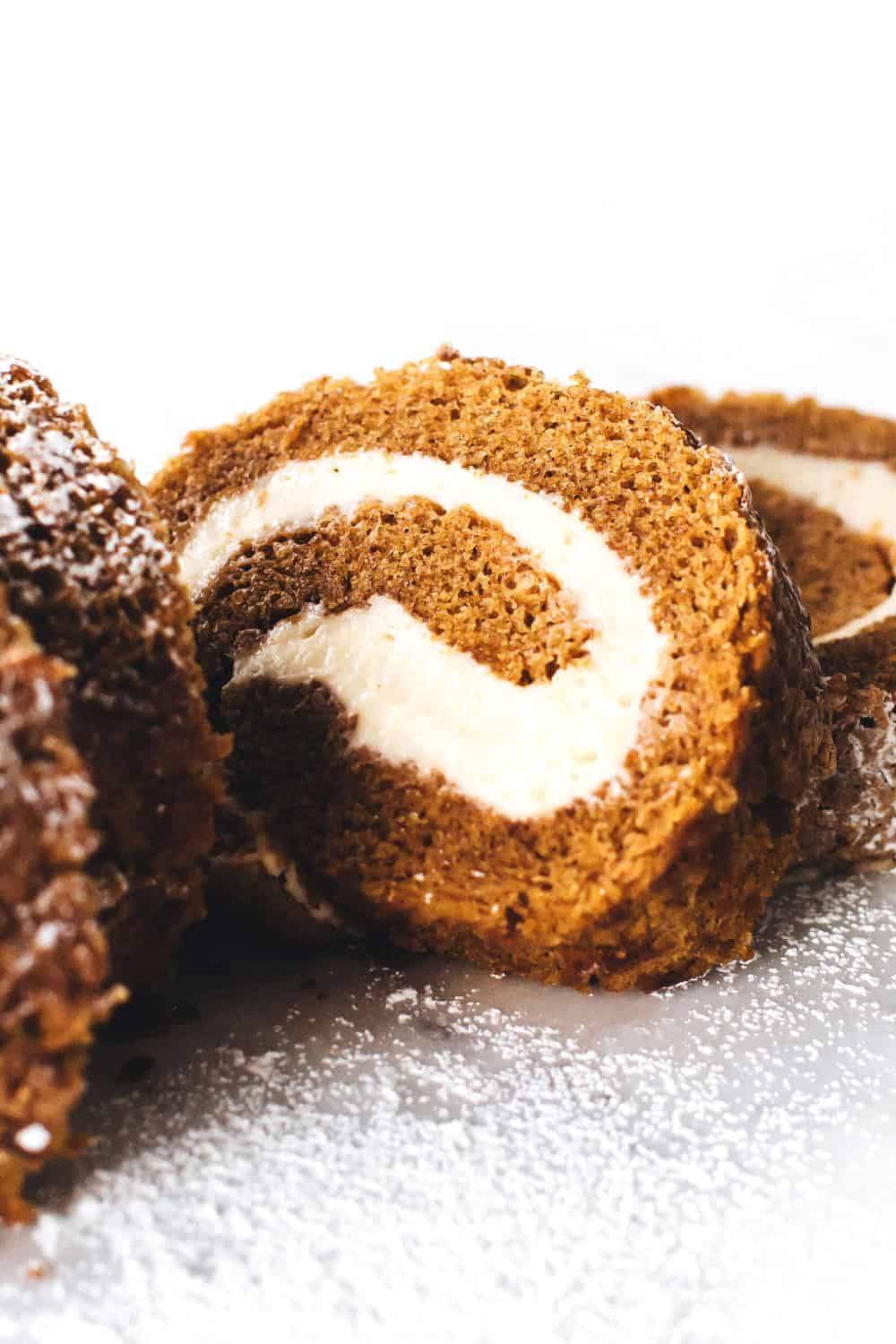 This pumpkin roll recipe is the perfect dessert to keep in the freezer for unexpected holiday guests.