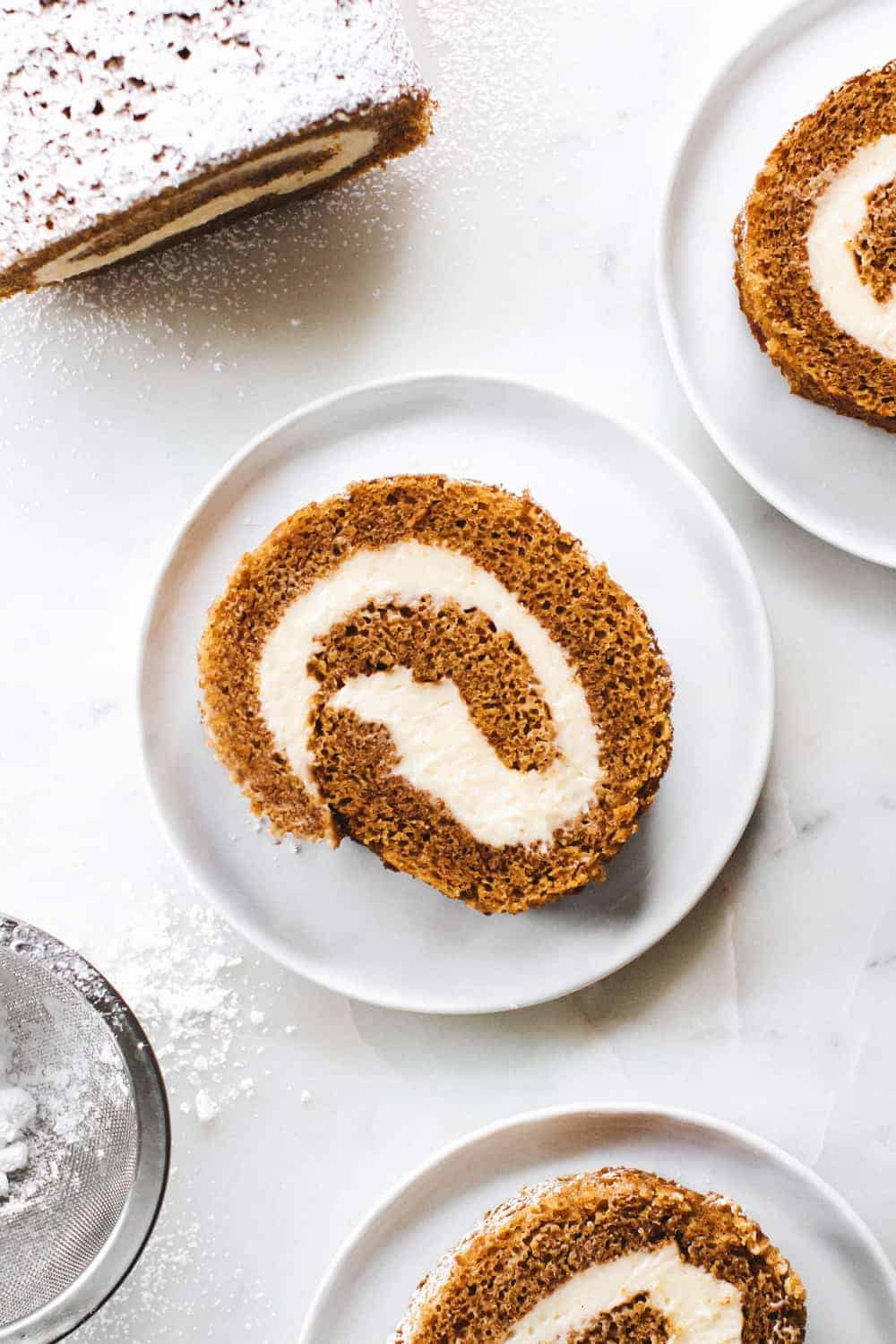 A classic pumpkin roll recipe complete with a delicious pumpkin cake and dreamy cream cheese filling.