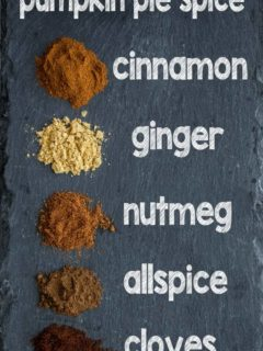 Ingredients to make pumpkin spice on a stone surface