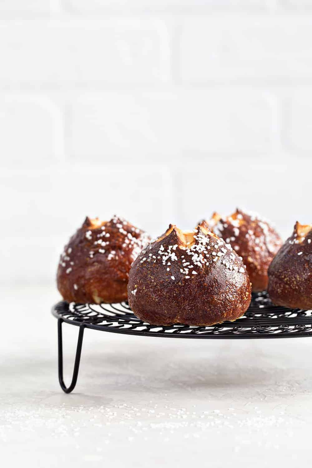 Fluffy Pretzel Rolls are the perfect addition to any dinner table. Fun and simple to make!