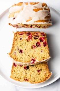 Cranberry Orange Bread is sweet, tart and bursting with fresh cranberries and the flavor of oranges. Perfect for breakfast or dessert!