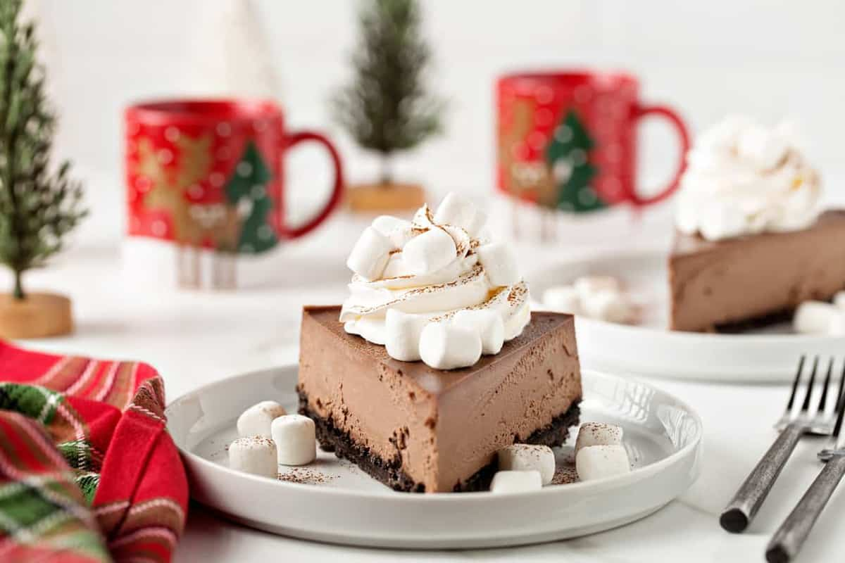 Hot Cocoa Cheesecake has all of the flavors of a cup of hot cocoa tucked into a rich, creamy cheesecake! You'll love this cheesecake, right down to the mini marshmallows on top.