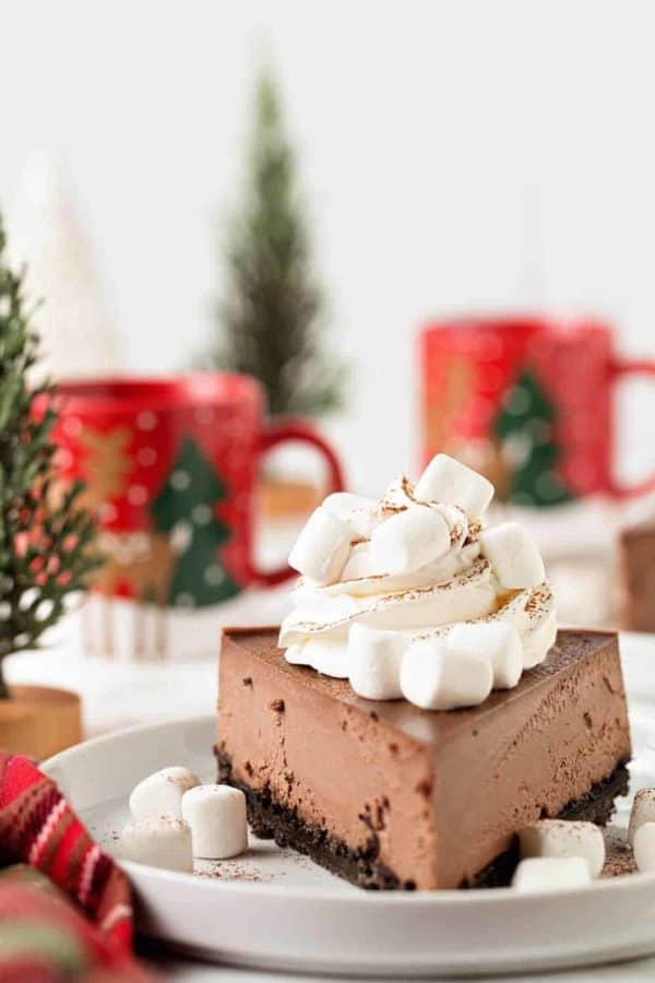 Hot Cocoa Cheesecake has all of the flavors of a cup of hot cocoa in a rich, creamy, chocolate cheesecake! You'll love everything about it, especially the fluffy marshmallows on top!