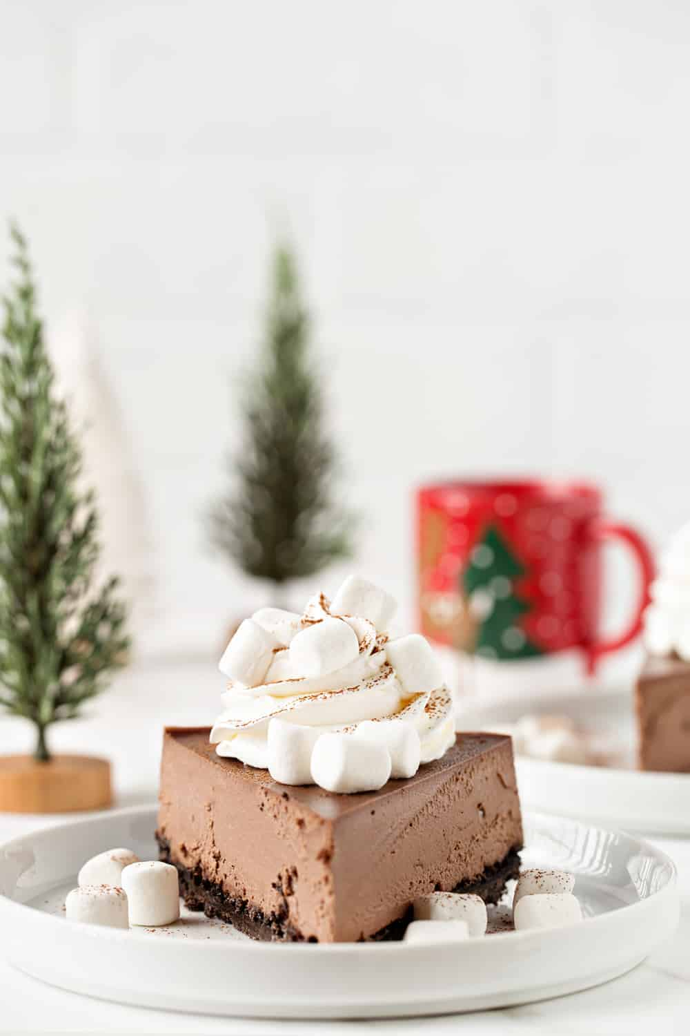 This Hot Cocoa Cheesecake is the perfect  dessert for any holiday party. Everyone will be begging you for the recipe!