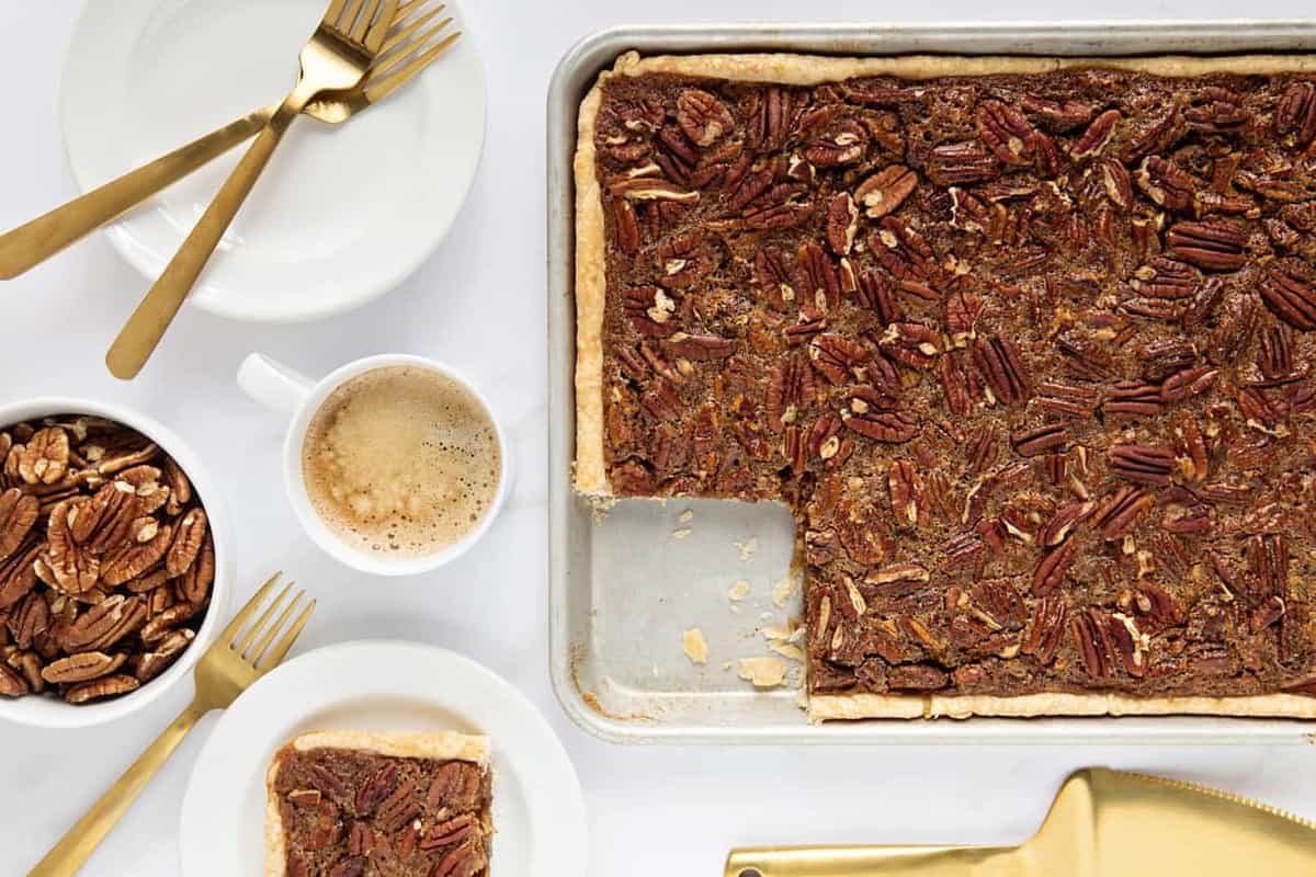 Pecan Slab Pie is going to be your new favorite Thanksgiving dessert. It's easy to make and feeds a crowd!